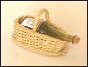 Bottle basket with glass bottle
